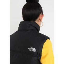 The North Face 1996 RETRO NUPTSE Kamizelka black. Różowe kamizelki damskie marki The North Face, m, z nadrukiem, z bawełny. Za 899,00 zł.