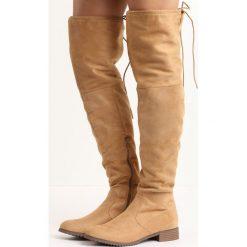 Camelowe Kozaki Edmonton. Brązowe buty zimowe damskie Born2be, z okrągłym noskiem, na płaskiej podeszwie. Za 119,99 zł.