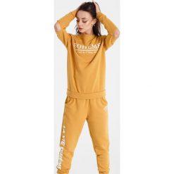 Naoko - Bluza Boheme Soleil x Edyta Górniak. Pomarańczowe bluzy z nadrukiem damskie marki NAOKO, l, z bawełny, bez kaptura. W wyprzedaży za 129,90 zł.