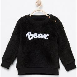 Futrzasta bluza - Czarny. Czarne bluzy niemowlęce marki Reserved, z napisami. Za 49,99 zł.