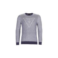 Swetry Guess  TAMAC. Niebieskie swetry klasyczne męskie marki Guess, l, z aplikacjami. Za 399,00 zł.