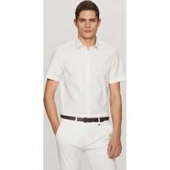 Koszula z krótkim rękawem - Biały. Białe koszule chłopięce marki Reserved, l. W wyprzedaży za 49,99 zł.