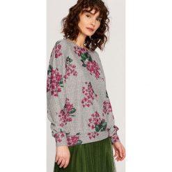 Bluza w kwiaty - Wielobarwn. Szare bluzy damskie marki ekoszale, xl, w kwiaty, z dresówki. W wyprzedaży za 49,99 zł.
