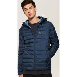 Pikowana kurtka z kapturem - Granatowy. Czarne kurtki damskie pikowane marki KIPSTA, z poliesteru, do piłki nożnej. Za 149,99 zł.