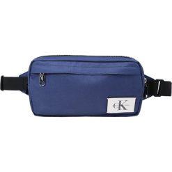 Calvin Klein Jeans SPORT ESSENTIAL SLING M Torba na ramię blue. Niebieskie torby na ramię męskie Calvin Klein Jeans, z jeansu. Za 299,00 zł.