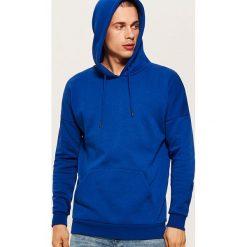 Bluza z kapturem - Niebieski. Niebieskie bejsbolówki męskie House, l, z kapturem. Za 89,99 zł.
