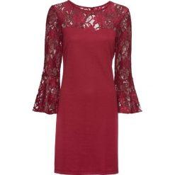 Sukienka z dżerseju z rozkloszowanymi rękawami bonprix ciemnoczerwony. Czerwone sukienki hiszpanki bonprix, z dżerseju, rozkloszowane. Za 149,99 zł.