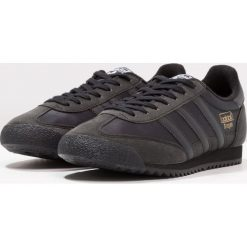 Adidas Originals DRAGON OG Tenisówki i Trampki core black. Szare tenisówki damskie marki adidas Originals, z gumy. W wyprzedaży za 258,30 zł.