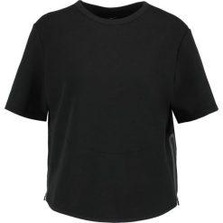 Nike Performance Koszulka sportowa black. Czarne topy sportowe damskie Nike Performance, xs, z bawełny. W wyprzedaży za 209,25 zł.