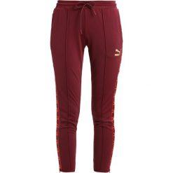 Spodnie dresowe damskie: Puma PANTS Spodnie treningowe burgundy