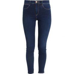 Wrangler HIGH Jeans Skinny Fit cosy feel. Niebieskie rurki damskie Wrangler, z bawełny. Za 349,00 zł.