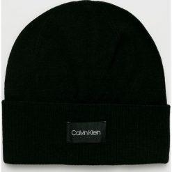 Calvin Klein - Czapka. Czarne czapki zimowe męskie marki Calvin Klein, na zimę, z dzianiny. Za 199,90 zł.