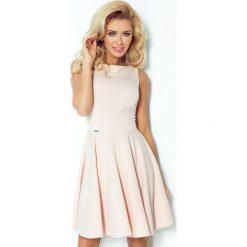 98-3 sukienka koło - dekolt łódka - lacosta pastelowy róż. Różowe sukienki na komunię marki numoco, l, z dekoltem w łódkę, oversize. Za 139,00 zł.