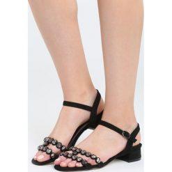 Czarne Sandały Inquisitive Nature. Czarne sandały damskie na słupku marki Born2be, z materiału, na wysokim obcasie. Za 69,99 zł.