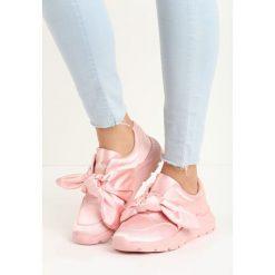 Różowe Buty Sportowe Pinky Winky. Czerwone buty sportowe damskie marki KALENJI, z gumy. Za 49,99 zł.