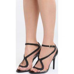 Czarne Sandały Amaretto. Czarne sandały damskie marki Born2be, z lakierowanej skóry, na wysokim obcasie, na obcasie. Za 89,99 zł.