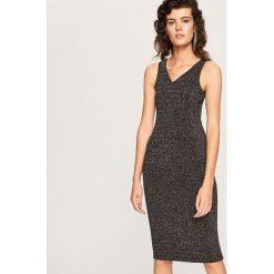 Sukienka z błyszczącej dzianiny - Czarny. Czarne sukienki dzianinowe marki Reserved, l. Za 59,99 zł.