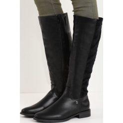 Czarne Kozaki Pick Me Too. Czarne buty zimowe damskie marki Kazar, z nubiku, przed kolano, na wysokim obcasie. Za 139,99 zł.