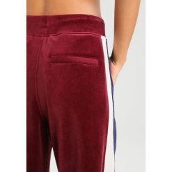 Fenty PUMA by Rihanna TRACK Spodnie treningowe tawny port/evening blue. Czerwone spodnie dresowe damskie Fenty PUMA by Rihanna, xs, z bawełny. W wyprzedaży za 607,20 zł.
