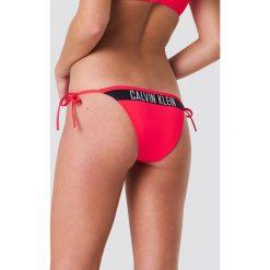 Calvin Klein Dół bikini Cheeky String Side Tie N - Red. Czerwone bikini marki Calvin Klein. Za 161,95 zł.