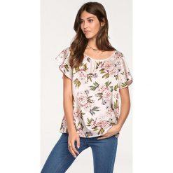 Odzież damska: Bluzka w kolorze kremowym ze wzorem