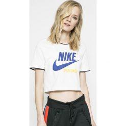 Nike Sportswear - Top. Różowe topy damskie marki Nike Sportswear, l, z nylonu, z okrągłym kołnierzem. W wyprzedaży za 99,90 zł.