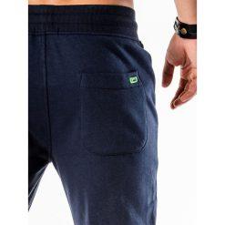 SPODNIE MĘSKIE DRESOWE P550 - GRANATOWE. Niebieskie spodnie dresowe męskie Ombre Clothing, z bawełny. Za 54,00 zł.