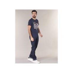 Jeansy straight leg Guess  MISBOW. Niebieskie jeansy męskie marki Guess. Za 351,20 zł.