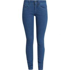 GStar LYNN DMID SUPER SKINNY WMN Jeans Skinny Fit medium aged od. Niebieskie rurki damskie G-Star, z bawełny. Za 609,00 zł.