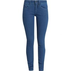 GStar LYNN DMID SUPER SKINNY WMN Jeans Skinny Fit medium aged od. Białe rurki damskie marki G-Star, z nadrukiem. Za 609,00 zł.