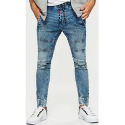 Jeansy SLIM JOGGER - Niebieski. Niebieskie jeansy męskie regular Cropp. Za 129,99 zł.