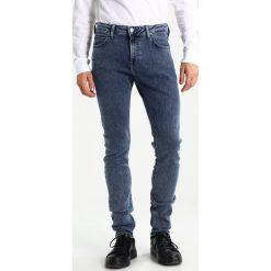 Spodnie męskie: Lee RIDER Jeansy Slim Fit pogo worn