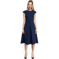 CINDERELLA Sukienka z kontrafałdą w spódnicy - granatowa. Niebieskie sukienki balowe Moe, z klasycznym kołnierzykiem, midi, dopasowane. Za 149,00 zł.