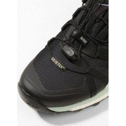 Adidas Performance TERREX SKYCHASER GTX Obuwie hikingowe core black/ash green. Brązowe buty sportowe damskie marki adidas Performance, z gumy. W wyprzedaży za 599,20 zł.