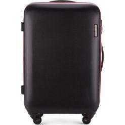 Walizka średnia 56-3-612-10. Czarne walizki marki Wittchen, z gumy, średnie. Za 249,00 zł.