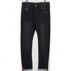 Ocieplane jeansy COMFORTY - Czarny. Czarne jeansy męskie marki Cropp. Za 149,99 zł.