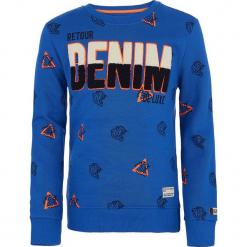 Bluza w kolorze niebieskim. Niebieskie bluzy chłopięce marki Retour Denim de Luxe, z aplikacjami, z materiału. W wyprzedaży za 115,95 zł.
