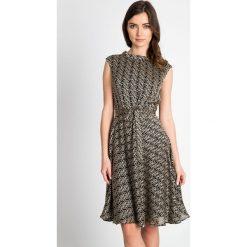 Sukienki: Złota rozkloszowana sukienka QUIOSQUE
