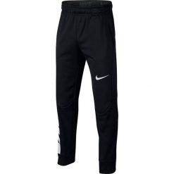 Chinosy chłopięce: Nike Spodnie dziecięce B NK Therma Pant GFX czarne r. L (158-170cm) (909082 011)