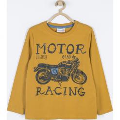Koszulka. Pomarańczowe t-shirty chłopięce z długim rękawem MOTORCYCLE CLUB, z aplikacjami, z bawełny. Za 49,90 zł.