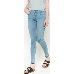 Levi's - Jeansy 710. Brązowe jeansy damskie Levi's®, z aplikacjami, z bawełny, z obniżonym stanem. W wyprzedaży za 229,90 zł.