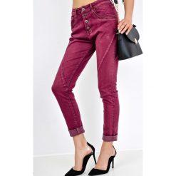 Rurki damskie: Spodnie jeansy rurki na guziki
