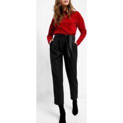 Spodnie z wysokim stanem. Brązowe spodnie z wysokim stanem marki Orsay, s, z dzianiny. Za 119,99 zł.