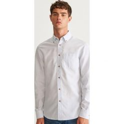 Koszula slim fit z bawełny organicznej - Biały. Czarne koszule męskie slim marki Reserved. Za 69,99 zł.
