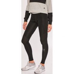 Adidas Performance - Legginsy. Czerwone legginsy we wzory marki adidas Performance, m. Za 169,90 zł.