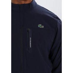 Lacoste Sport Kurtka Outdoor marine. Niebieskie kurtki trekkingowe męskie Lacoste Sport, m, z elastanu. W wyprzedaży za 546,75 zł.