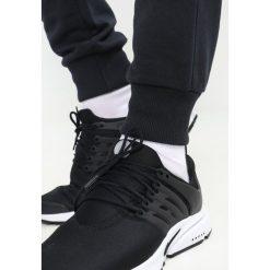 Jeansy męskie regular: Calvin Klein Jeans HOROS  Spodnie treningowe black