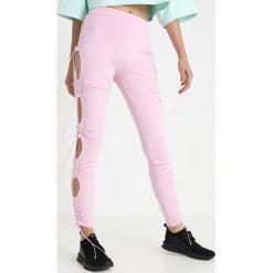 Fenty PUMA by Rihanna RUCHING Legginsy pink lady. Czerwone legginsy Fenty PUMA by Rihanna, m, z elastanu. Za 839,00 zł.
