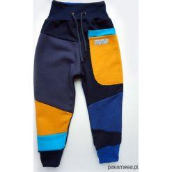 PATCH PANTS spodnie 104 - 152 cm granat & żółty. Żółte spodnie dresowe dziewczęce Pakamera, z dresówki. Za 109,00 zł.