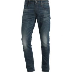 GStar 3301 SLIM Jeansy Slim Fit beln stretch denim. Białe jeansy męskie marki G-Star, z nadrukiem. Za 559,00 zł.